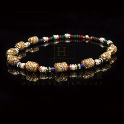 Picture of Gold chunks mala with ruby emeralds  pearls and sapphires
