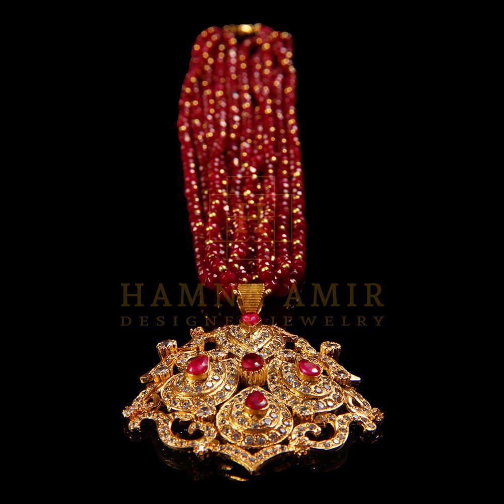 Picture of Gold plated ruby and zircon mala